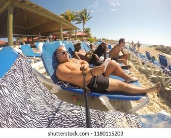 Eleuthera Island, Bahamas - 2016. Tourists on sunbeds in Princess Cays.