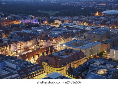Elevated cityscape of the centre of Leipzig illuminated at dusk