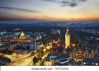 Elevated cityscape of the centre of Leipzig illuminated at dusk with tower of the Neue Rathaus (New Rathaus)