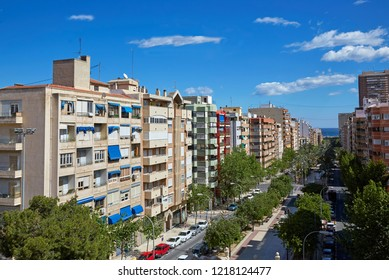 Elevated view of apartments and condos in Alicante under blue skies
