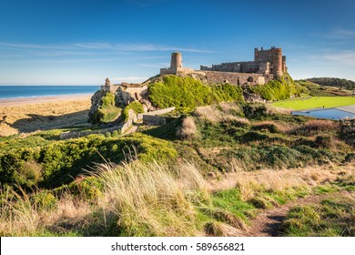 Elevated View of Bamburgh Castle / Bamburgh Castle viewed from an elevated hillock, on the Northumberland coastline