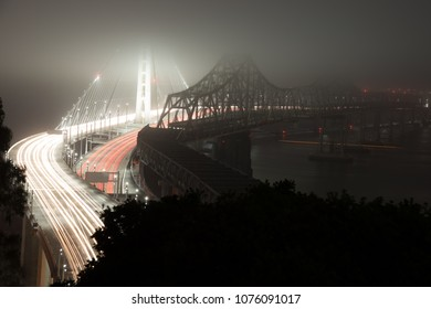 Elevated view of the Bay Bridge lit up at night, San Francisco, North Beach, California, USA