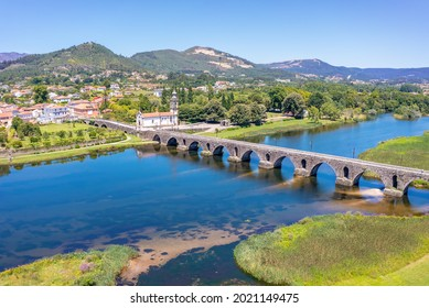An elevated view of the beautiful medieval bridge crossing the River Lima, Portugal, which dates back to 1368.