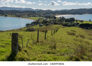 Elevated view of Bland Bay on the isthmus of the Whangaruru Harbour peninsula, Northland, New Zealand.