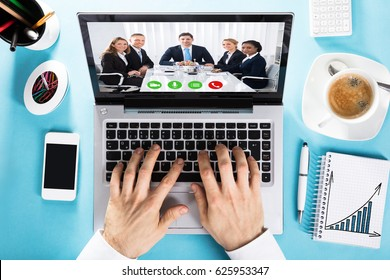 Elevated View Of A Businessman Chatting With Her Colleague On Video Conference