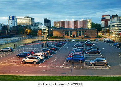 Elevated view of car park in the redeveloped office area of Swindon illuminated at dusk
