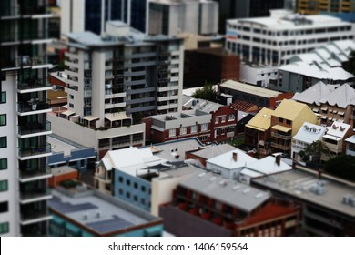 Elevated view of a city in minature effect. Tilt shift effect of city in Australia with old buildings rooftops and balconies
