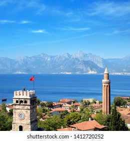 elevated view of cityscape image of historic district of Antalya over Mediterranean sea and high mountains with clear blue sky in Turkey