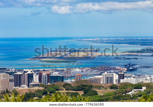 Elevated view of the Daniel K. Inouye International Airport, Oahu, Hawaii with the Pacific Ocean behind
