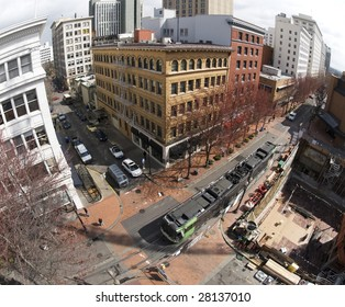An elevated view of downtown Portland, OR. Public transportation runs through the business district.