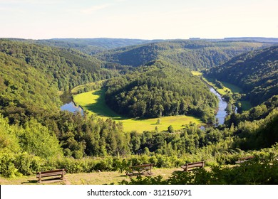 Elevated view from famous panoramic viewpoint of beautiful The Giant's tomb lying inside the bend of the river Semois. It is located nearby the city of Bouillon, Wallonia, Ardennes, Belgium.