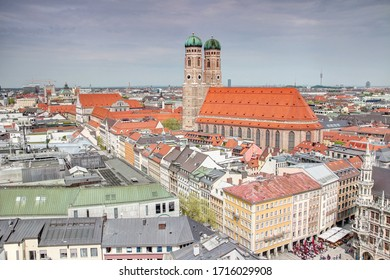 Elevated view of Gothic Frauenkirche cathedral, landmark building of the city,  rising high above the roofs of old town / historic center Altstadt near Marienplatz square Munchen Bayern Germany Europe