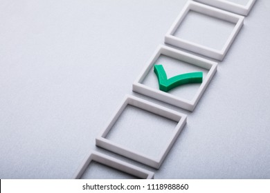 Elevated View Of Green Check Mark In Checkbox On Gray Background