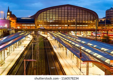 Elevated view of Hamburg central railway train station with platfroms illuminated at night, Germany