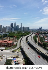 Elevated view of Kuala Lumpur Skyline on a hot day