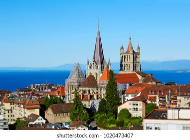 Elevated view of the lakeside city of Lausanne with spire of St Francois Church