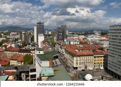 Elevated view of Ljubljana capital city of Slovenia north from the Skyscraper to the Kamnik Savinja Alps under clouds