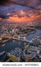Elevated view of the London skyline: from the Tower Bridge to the financial district Canary Wharf just after sunset, United Kingdom
