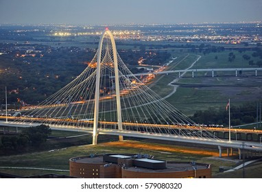 Elevated view of the 'Margaret Hunt Hill Bridge' at dusk in Texas, designed by Santiago Calatrava