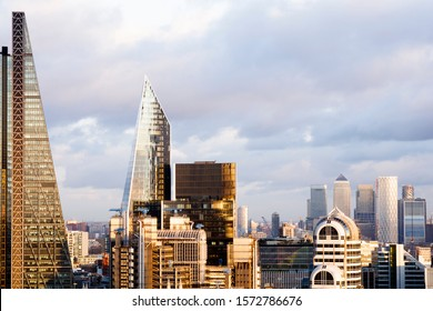 Elevated view of Modern London skyline at sunset