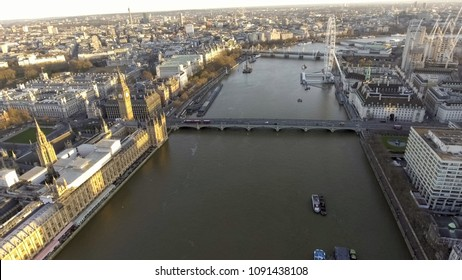 Elevated view over the City of London along the River Thames at Sunset. Big Ben Westminster Palace Parliament, St Thomas Hospital, Eye Observation Wheel on the Riverside in England, United Kingdom UK