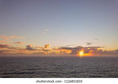 elevated view over the ocean landscape with horizon and sunset sunrise clouded sky