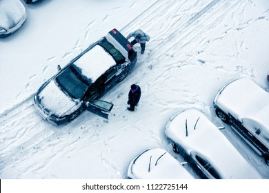 elevated view of parked cars covered with snow