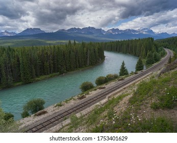 Elevated view of railway tracks along a river, Bow River, Bow Valley Parkway, Banff National Park, Alberta, Canada
