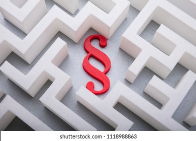 Elevated View Of Red Paragraph Symbol In The Centre Of White Maze