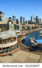 Elevated view of Seattle Skyline and restaurants on sunny day in Bell Harbor Marina. Seattle, Washington, USA, North America 20 September 2017
