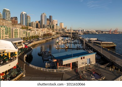 Elevated view of Seattle Skyline and restaurants in Bell Harbour Marina in golden hour, Belltown District. Seattle, Washington, USA, North America 21 September 2017