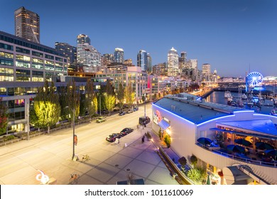 Elevated view of Seattle Skyline and traffic on Alaskan Way at dusk, Belltown District. Seattle, Washington, USA, North America 21 September 2017