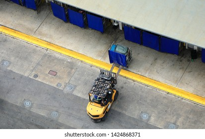 elevated view of single forklift working on commercial dock