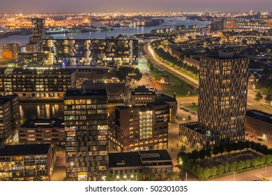 Elevated view of the skyline and port of Rotterdam (The Netherlands) at dusk.