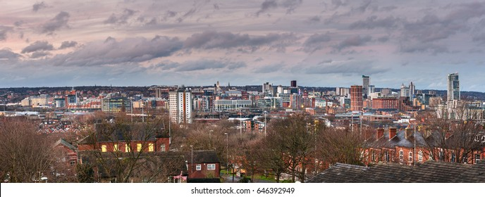 Elevated view of skyscrapers, hotels and ware houses in the North of Leeds under blue skies