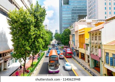 Elevated view of traffic on Singapore city street with modern colorful architecture