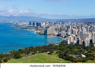 Elevated view of the Waikiki coastline from Kapiolani Regional Park to Waikiki Kakaako International airport in a scenic landscape on a sunny day