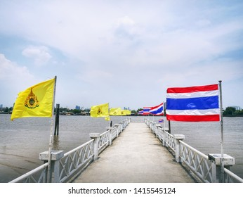 Elevated Walkway Over the River Decorated with National Flags of Thailand