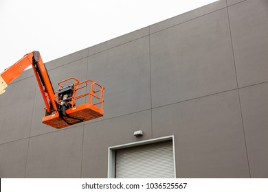 Elevating Work Platform by a Warehouse