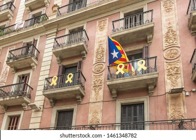 Elevation of a building in Barcelona in Catalonia with signs of sympathy with the Catalan seperatists demanding the independence of Catalonia separating Catalonia from Spain