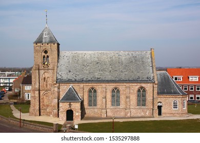 Elevation of the Catharinakerk church in Zoutelande village with its gothic brick tower in Veere, Zeeland, the Netherlands