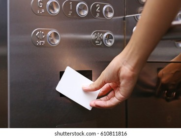 elevator access control, Hand holding a key card to unlock elevator floor befor up or down