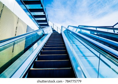The elevator against the blue sky and cloud of a city outdoor