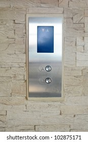 Elevator buttons on sandstone