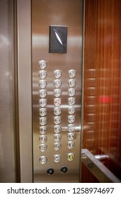 Elevator buttons panel. Number floor selection button in the lift. Inside the metal with reflected.