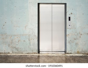 elevator with closed door with wall background
