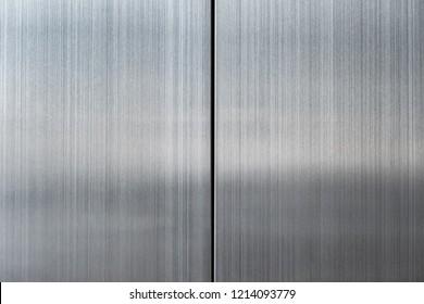 Elevator door, detail of a shiny metallic background
