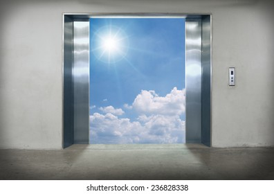 Elevator doors open to the blue sky.