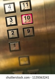 Elevator or lift numeric indicator at 10th floor with low light supply illustrated numbers and Braille signs language