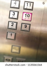 Elevator or lift numeric indicator at 9th floor with low light supply illustrated numbers and Braille signs language
